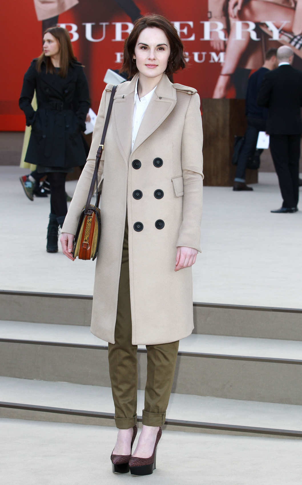LONDON, UNITED KINGDOM - FEBRUARY 18: Michelle Dockery attends the Burberry Prorsum show during London Fashion Week Fall/Winter 2013/14 at  on February 18, 2013 in London, England. (Photo by Fred Duval/Getty Images)