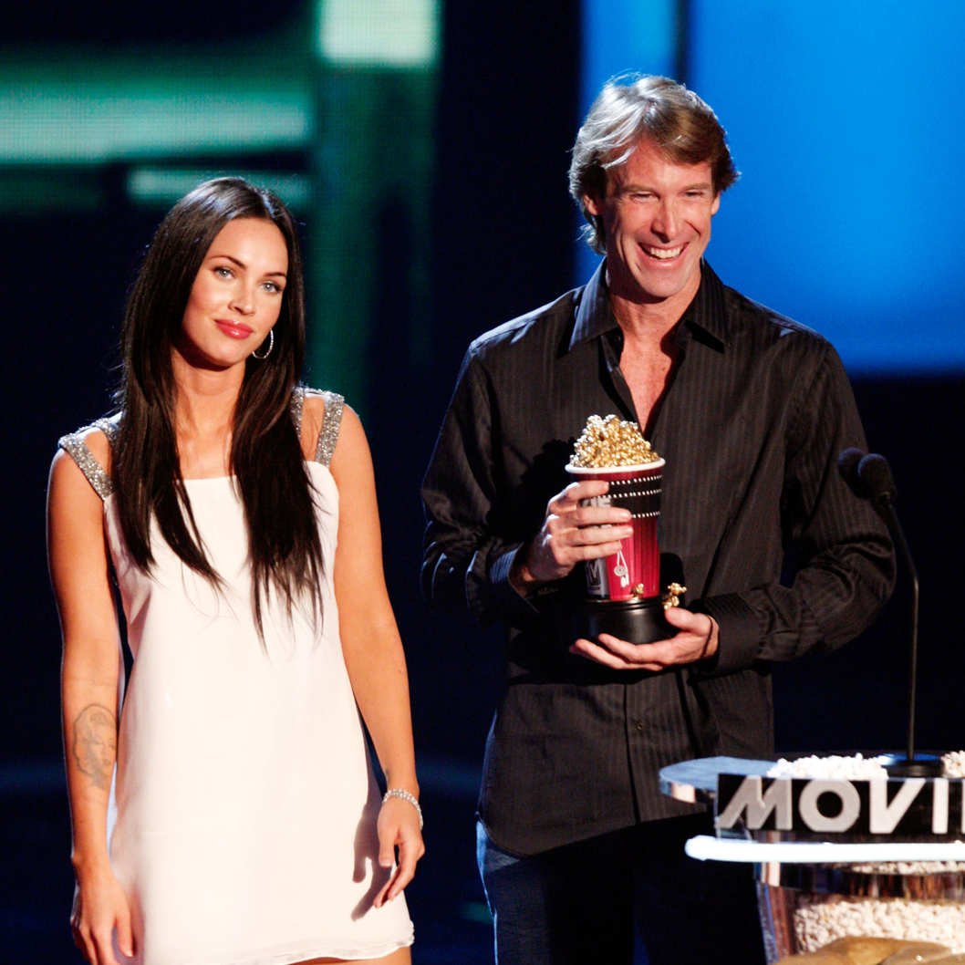 "UNIVERSAL CITY, CA - JUNE 01:  Actress Megan Fox (L) and director Michael Bay accept the award for Best Movie for ""Transformers"" during the 17th annual MTV Movie Awards held at the Gibson Amphitheatre on June 1, 2008 in Universal City, California.  (Photo by Kevin Winter/Getty Images)"