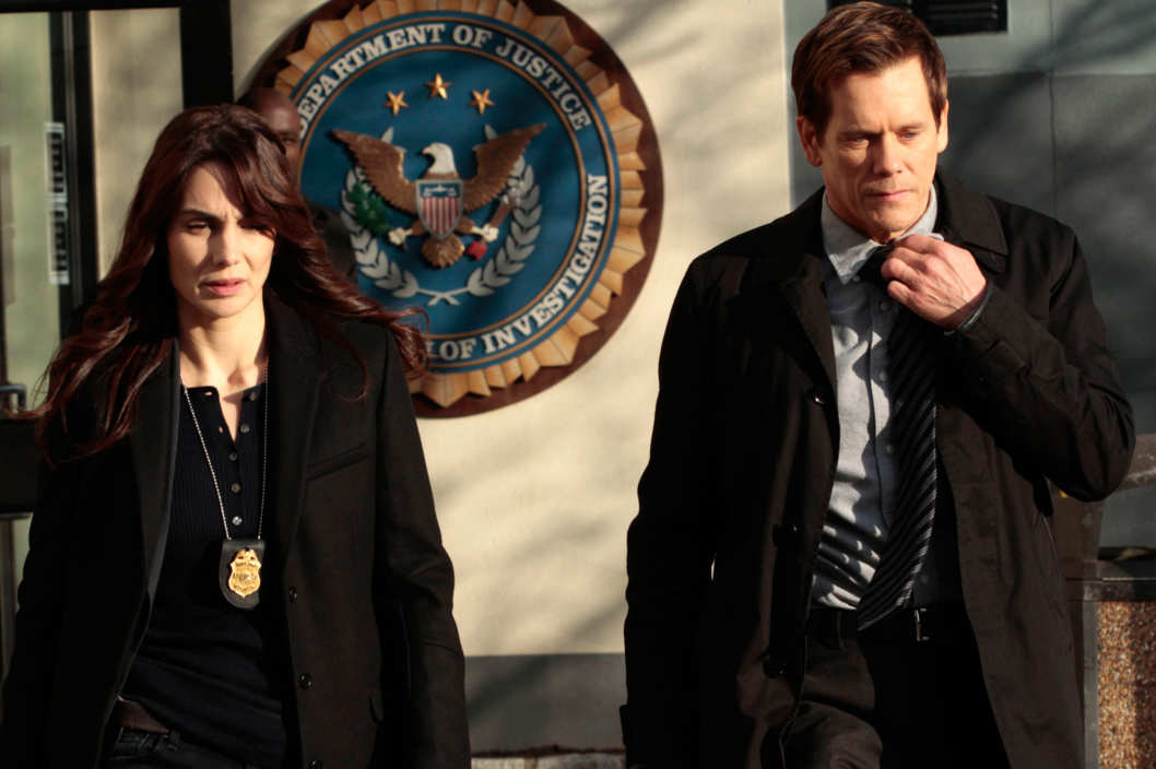 "THE FOLLOWING: Special Agent Parker (Annie Parisse, L) and Ryan  (Kevin Bacon, R) leave the FBI bureau in the ""Love Hurts"" episode of THE FOLLOWING airing Monday, March 18 (9:00-10:00 PM ET/PT)"