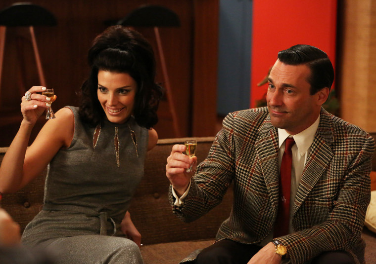 Megan Draper (Jessica Pare) and Don Draper (Jon Hamm) - Mad Men - Season 6, Episode 2 - Photo Credit: Michael Yarish/AMC