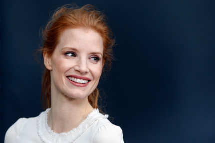 US actress Jessica Chastain poses on March 5, 2013 as she arrives to attend Chanel's Fall/Winter 2013-2014 ready-to-wear collection show at the Grand Palais in Paris.