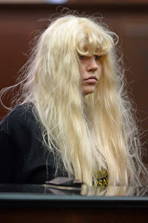 Amanda Bynes appears in court in NYC facing charges of reckless endangerment, tampering with evidence and marijuana possession after allegedly throwing a bong from her apartment window.