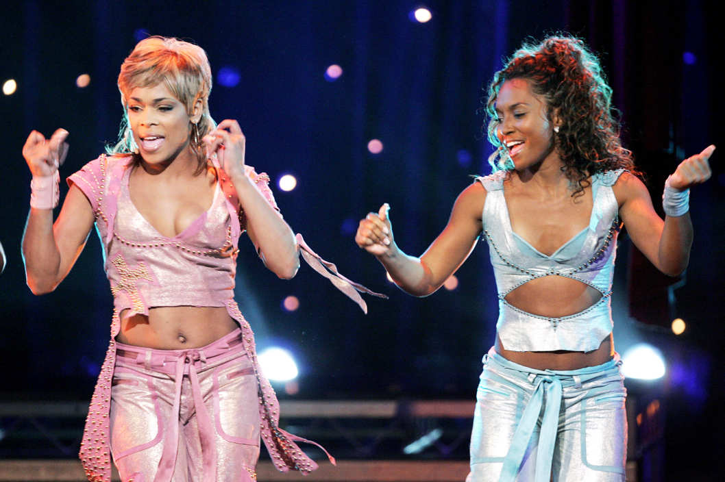 "Rozonda ""Chilli"" Thomas (L) and Tionne ""T-Boz"" Watkins of the musical group TLC perform during the finale of the UPN televison reality show ""R U The Girl"" at the Orpheum Theatre on September 20, 2005 in Los Angeles, California."