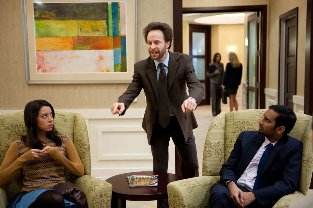 "PARKS AND RECREATION -- ""Partridge"" Episode 517 -- Pictured: (l-r) Aubrey Plaza as April Ludgate, Jon Glaser as Councilman Jamm, Aziz Ansari as Tom Haverford ."