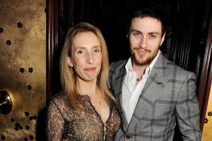 LONDON, ENGLAND - JANUARY 09:  (EMBARGOED FOR PUBLICATION IN UK TABLOID NEWSPAPERS UNTIL 48 HOURS AFTER CREATE DATE AND TIME. MANDATORY CREDIT PHOTO BY DAVE M. BENETT/GETTY IMAGES REQUIRED)  Sam Taylor-Wood (L) and Aaron Taylor-Johnson attend a private dinner hosted by Tom Ford to celebrate his runway show during London Collections: MEN AW13 at Loulou's on January 9, 2013 in London, England.  (Photo by Dave M. Benett/Getty Images)