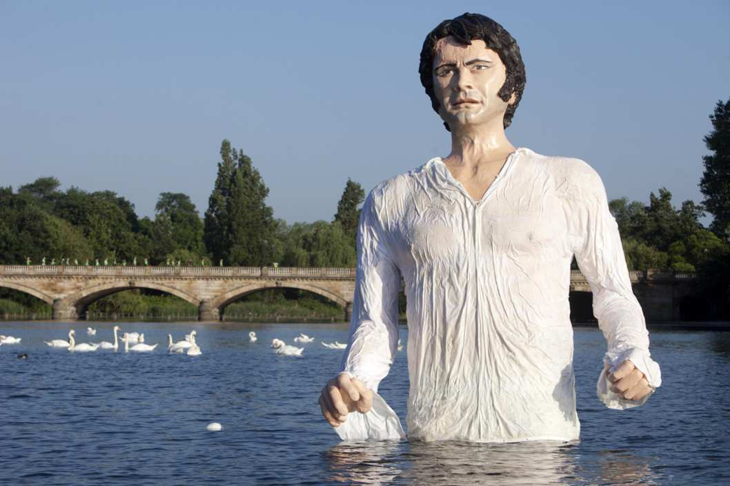 UKTV launch new free channel. EDITORIAL USE ONLY A statue of Jane Austen's romantic hero Mr Darcy in The Serpentine in London's Hyde Park to celebrate the launch of UKTV's new free channel 'Drama'. Picture date: Monday July 8, 2013. The 12 foot statue, which took a team of three sculptors over two months to design, construct and paint, pays homage to the show-stealing lake scene that was voted one of the most memorable British TV drama moments of all time and marks the 200th anniversary of the publication of Pride and Prejudice in 1813. New channel Drama is available on Freeview channel 20 and Sky. Photo credit should read: David Parry/PA Wire URN:17006101