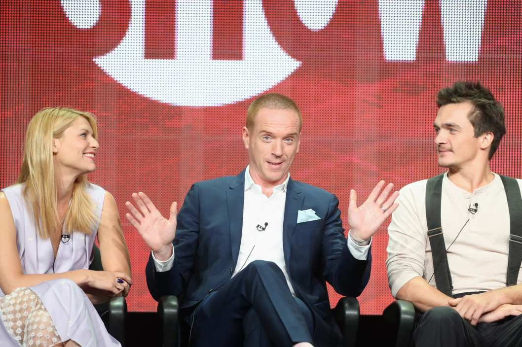 "BEVERLY HILLS, CA - JULY 29:  (L-R) Actors Claire Danes, Damian Lewis and Rupert Friend speak onstage during the ""Homeland"" panel discussion at the CBS, Showtime and The CW portion of the 2013 Summer Television Critics Association tour at the Beverly Hilton Hotel on July 29, 2013 in Beverly Hills, California.  (Photo by Frederick M. Brown/Getty Images)"