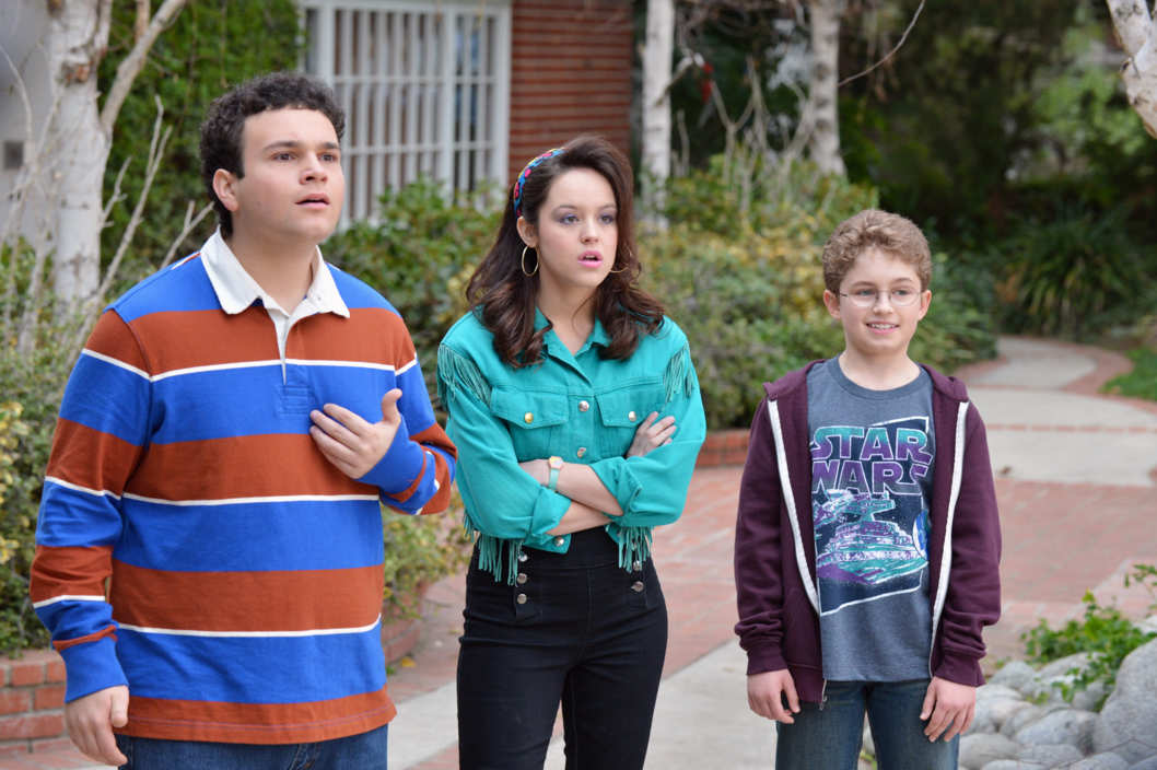 "THE GOLDBERGS - ""The Goldbergs"" stars Wendi McLendon-Covey (""Bridesmaids"") as Beverly Goldberg, Patton Oswalt (""Ratatouille"") as adult Adam Goldberg, Sean Giambrone as Adam Goldberg, Troy Gentile (""Good Luck Chuck"") as Barry Goldberg, Hayley Orrantia (""The X Factor"") as Erica Goldberg, with George Segal (""Don't Shoot Me"") as Pops Solomon and Jeff Garlin (""Curb Your Enthusiasm"") as Murray Goldberg. ""The Goldbergs"" was written and executive-produced by Adam F. Goldberg (""Breaking In,"" ""Fanboys"") and also executive-produced by Doug Robinson and Seth Gordon. The pilot was directed by Seth Gordon (""Identity Thief,"" ""Horrible Bosses""). ""The Goldbergs"" is from Adam Sandler's production company, Happy Madison, and is produced by Sony Pictures Television.  (ABC/Eric McCandless)TROY GENTILE, HAYLEY ORRANTIA, SEAN GIAMBRONE"