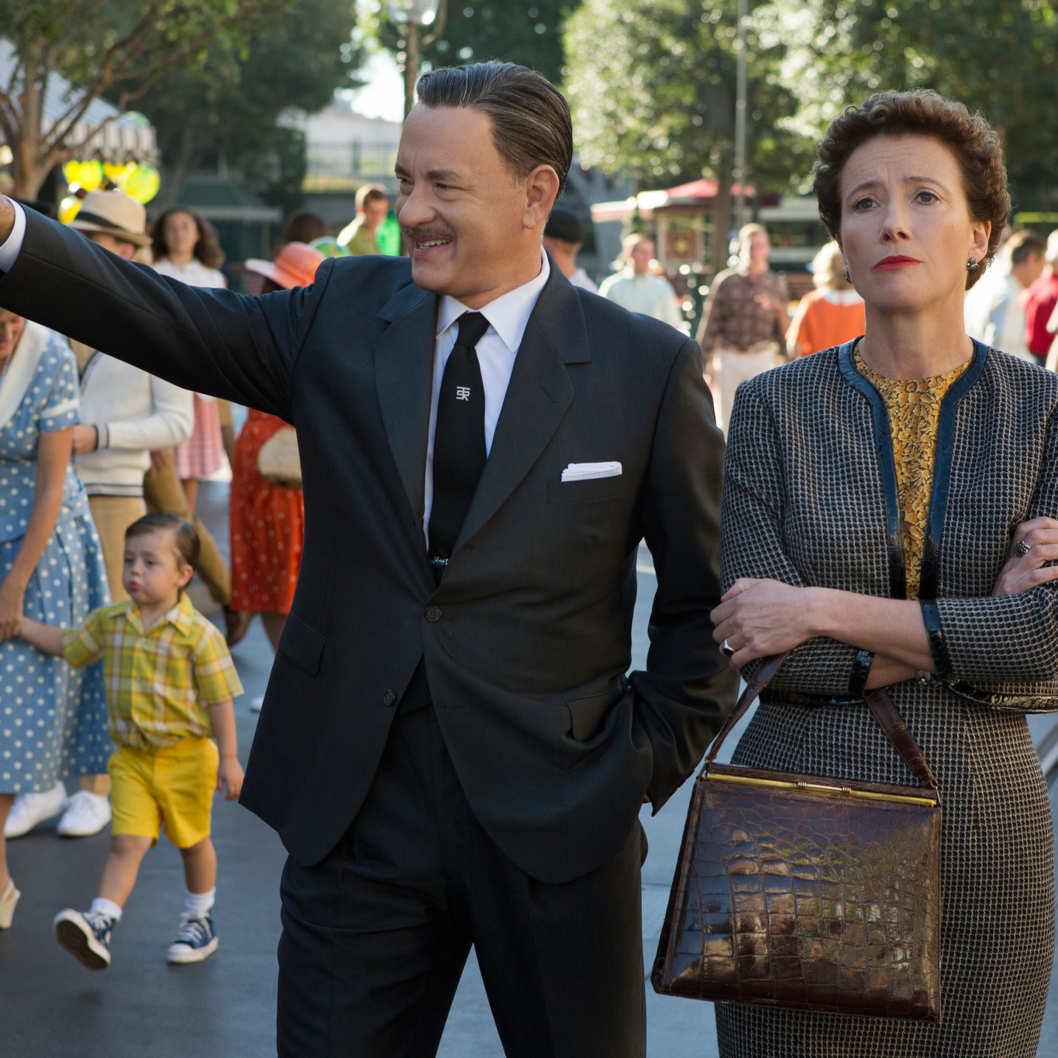 """SAVING MR. BANKS""  SMB_05582FD Walt Disney (Tom Hanks) shows?Disneyland to ""Mary Poppins"" author P.L. Travers (Emma Thompson) in Disney's ""Saving Mr. Banks,""?releasing in U.S. theaters limited on December 13, 2013 and wide on December 20, 2013.  Ph: Fran?ois Duhamel  ?Disney Enterprises, Inc.  All Rights Reserved."