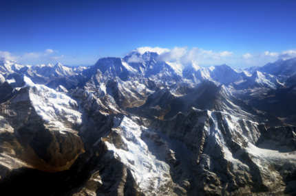 This photograph taken from an aircraft shows an aerial view of Mount Everest (C) and The Himalayan mountain range, some 140kms (87 miles) north-east of Kathmandu on April 3, 2013, on the 80th anniversary of the first manned flight over Mount Everest, the world's tallest mountain.  This year is the 60th anniversary of the first summit of the 8848-metre peak.    AFP PHOTO/Prakash MATHEMA        (Photo credit should read PRAKASH MATHEMA/AFP/Getty Images)