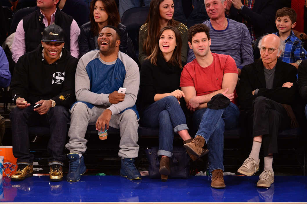 NEW YORK, NY - NOVEMBER 10:  Nelly, guest, Lia Smith, Justin Bartha and Larry David attend the San Antonio Spurs vs New York Knicks game at Madison Square Garden on November 10, 2013 in New York City.  (Photo by James Devaney/FilmMagic)