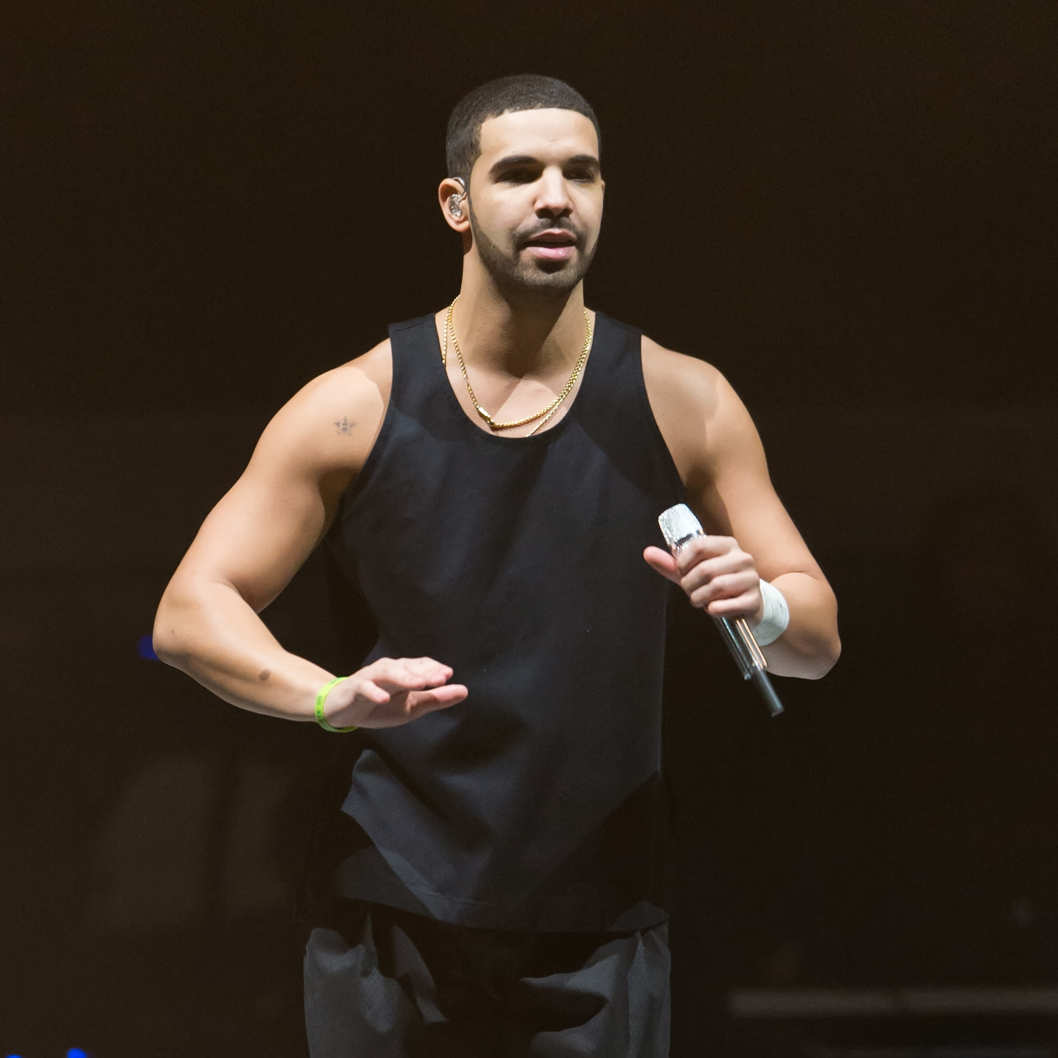 "PHILADELPHIA, PA - DECEMBER 18:  Rapper Drake performs during the ""Would You Like A Tour? 2013 concert at Wells Fargo Center on December 18, 2013 in Philadelphia, Pennsylvania.  (Photo by Gilbert Carrasquillo/Getty Images)"