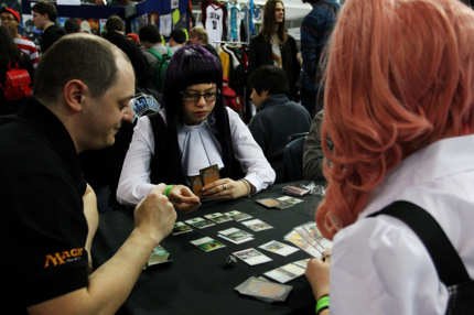 SYDNEY, AUSTRALIA - JUNE 23:  Sydneysiders play a card game 'Magic The Gathering' during the 2013 Supanova pop culture festival at Sydney Showground on June 23, 2013 in Sydney, Australia.  (Photo by Lisa Maree Williams/Getty Images)