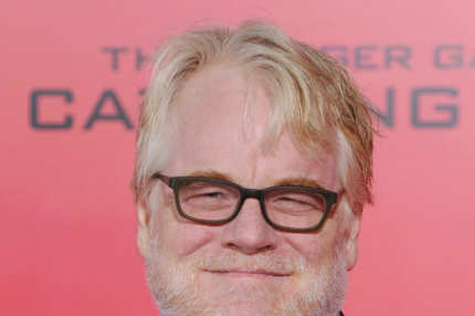 "LOS ANGELES, CA - NOVEMBER 18:  Actor Philip Seymour Hoffman arrives at the Los Angeles Premiere ""The Hunger Games: Catching Fire"" at Nokia Theatre L.A. Live on November 18, 2013 in Los Angeles, California.  (Photo by Jon Kopaloff/FilmMagic)"