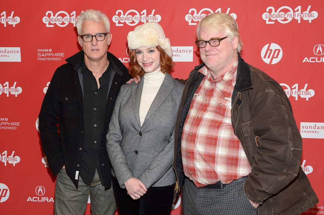 "PARK CITY, UT - JANUARY 17:  Director John Slattery, Christina Hendricks and Philip Seymour Hoffman attend the ""God's Pocket"" premiere at Eccles Center Theatre during the 2014 Sundance Film Festival on January 17, 2014 in Park City, Utah.  (Photo by Michael Loccisano/Getty Images for Sundance Film Festival)"