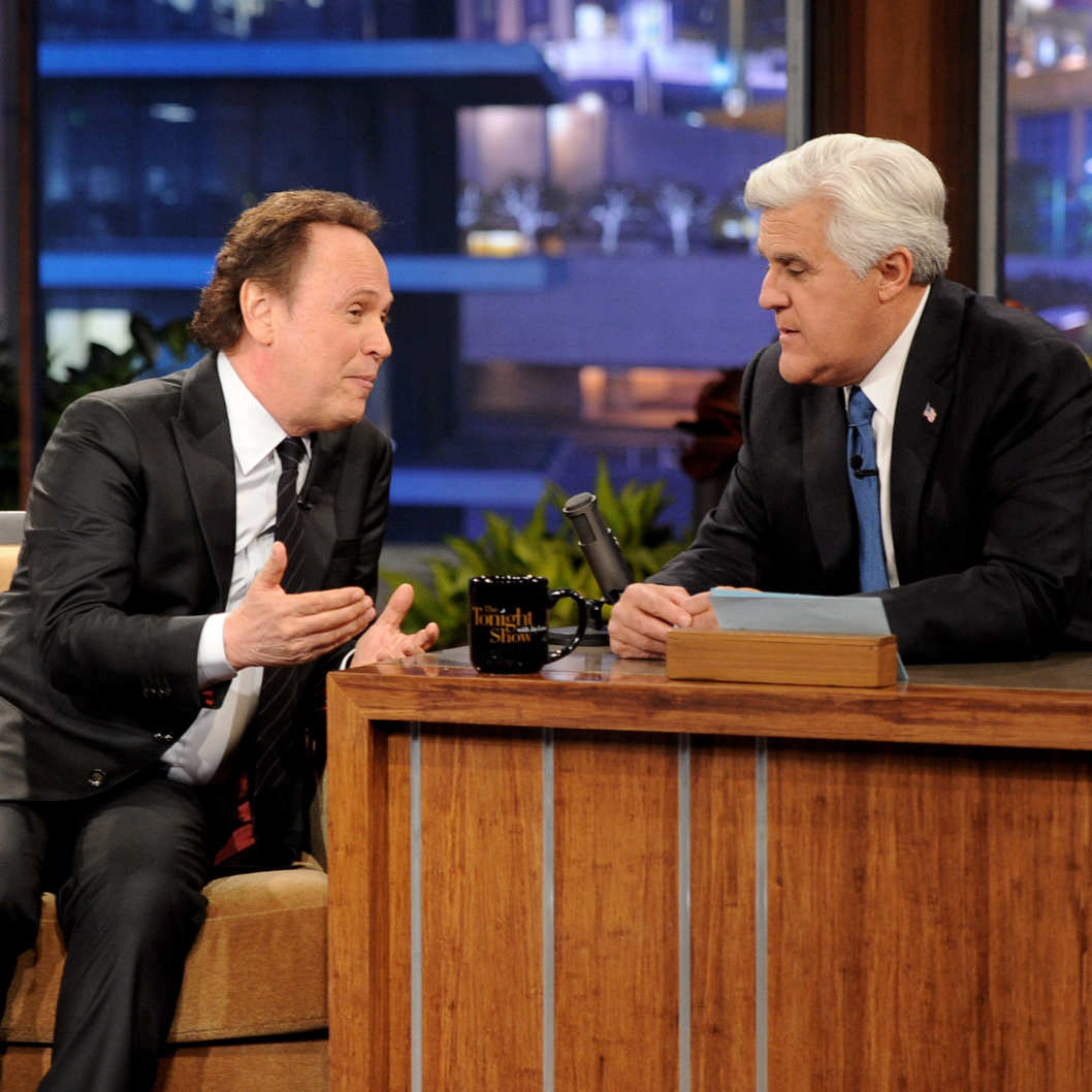 "BURBANK, CA - FEBRUARY 06:  Actor Billy Crystal (L) and comedian Jay Leno appear onstage during a commercial break on the final episode of ""The Tonight Show with Jay Leno"" at The Burbank Studios on February 6, 2014 in Burbank, California.  (Photo by Kevin Winter/Getty Images)"