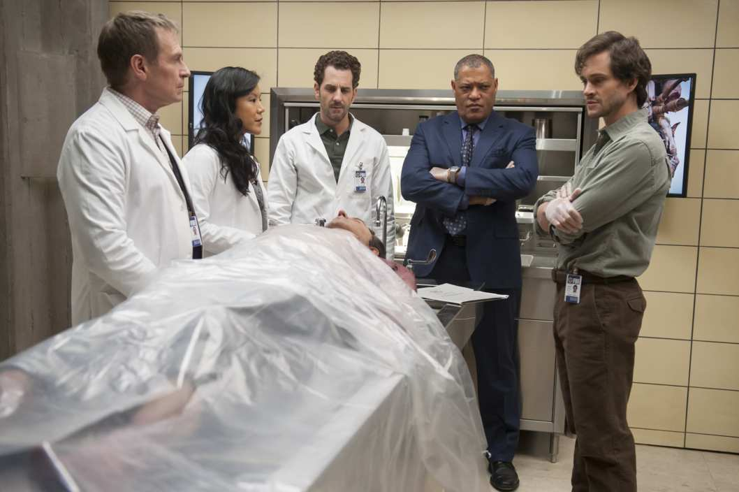 "HANNIBAL -- ""Trou Normand"" Episode 109 -- Pictured: (l-r) Scott Thompson as Jimmy Price, Hettienne Park as Beverly Katz, Aaron Abrams as Brian Zeller, Laurence J. Fishburne III as Jack Crawford, Hugh Dancy as Will Graham -- (Photo by: Brooke Palmer/NBC)"