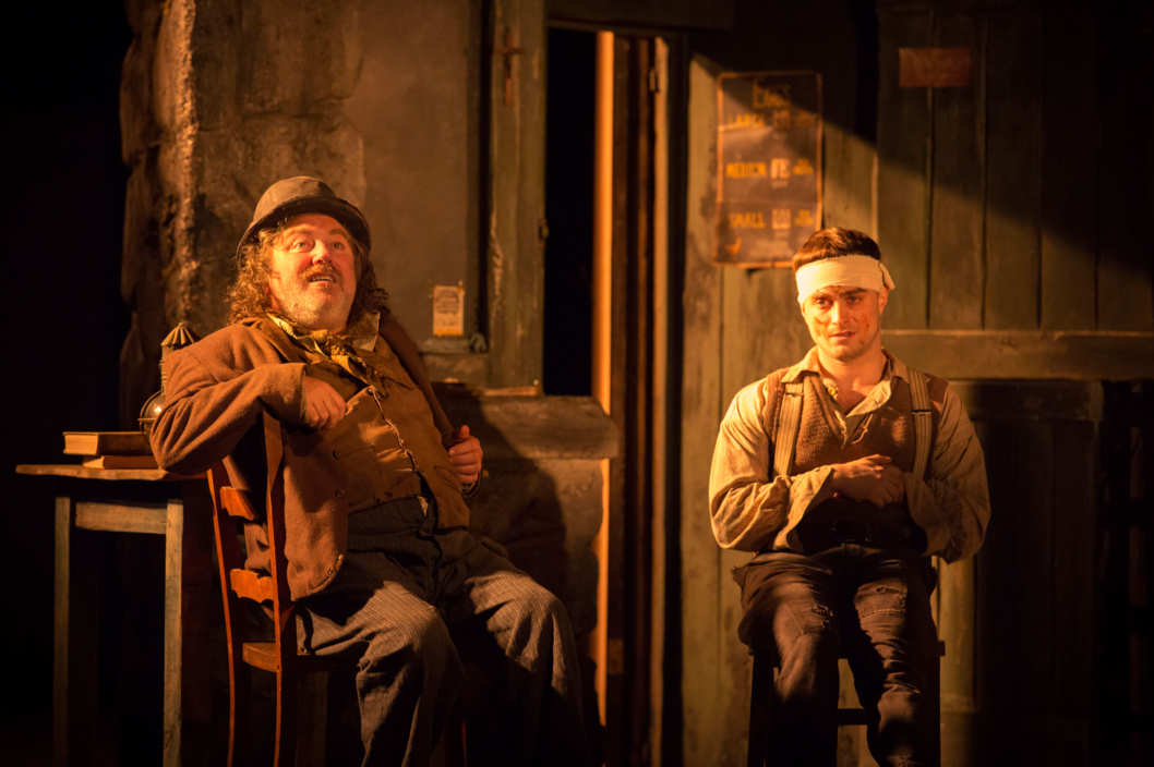 THE CRIPPLE OF INISHMAAN(l-r) Pat Shortt (Johnnypateenmike) and Daniel Radcliffe (Billy) in THE CRIPPLE OF INISHMAAN, by Martin McDonagh, directed by Michael Grandage.  Previews April 12, opening April 20 at the Cort Theatre (138 West 48th Street).? Johan Persson