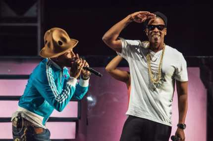 INDIO, CA - APRIL 19:  Musicians Pharrell Williiams (L) and Jay Z perform onstage during day 2 of the 2014 Coachella Valley Music & Arts Festival at the Empire Polo Club on April 19, 2014 in Indio, California.  (Photo by Christopher Polk/Getty Images for Coachella)