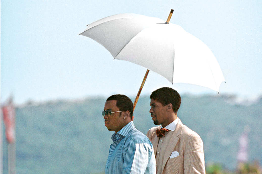 Mandatory Credit: Photo by BEImages (588594h)Sean 'P. Diddy' Combs and Farnsworth BentleySean 'P. Diddy' Combs at Club 55July 27, 2001 - Saint Tropez, FranceSean 'P. Diddy' Combs and Farnsworth Bentley (holding umbrella) at Club 55.Photo ? Ghost/Maxppp/BEImages***U.S. SALES ONLY!***