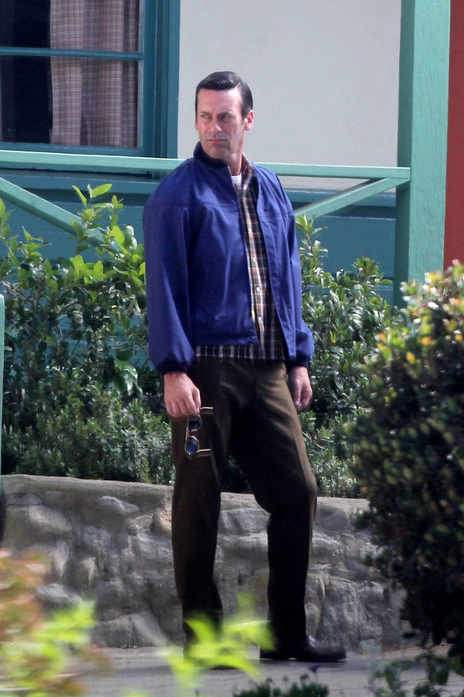 Jon Hamm films a scene for 'Mad Men' in LA. The actor could be seen getting out of a classic car wearing a blue jacket with his hair slicked back. Los Angeles, California - Monday June 16, 2014.