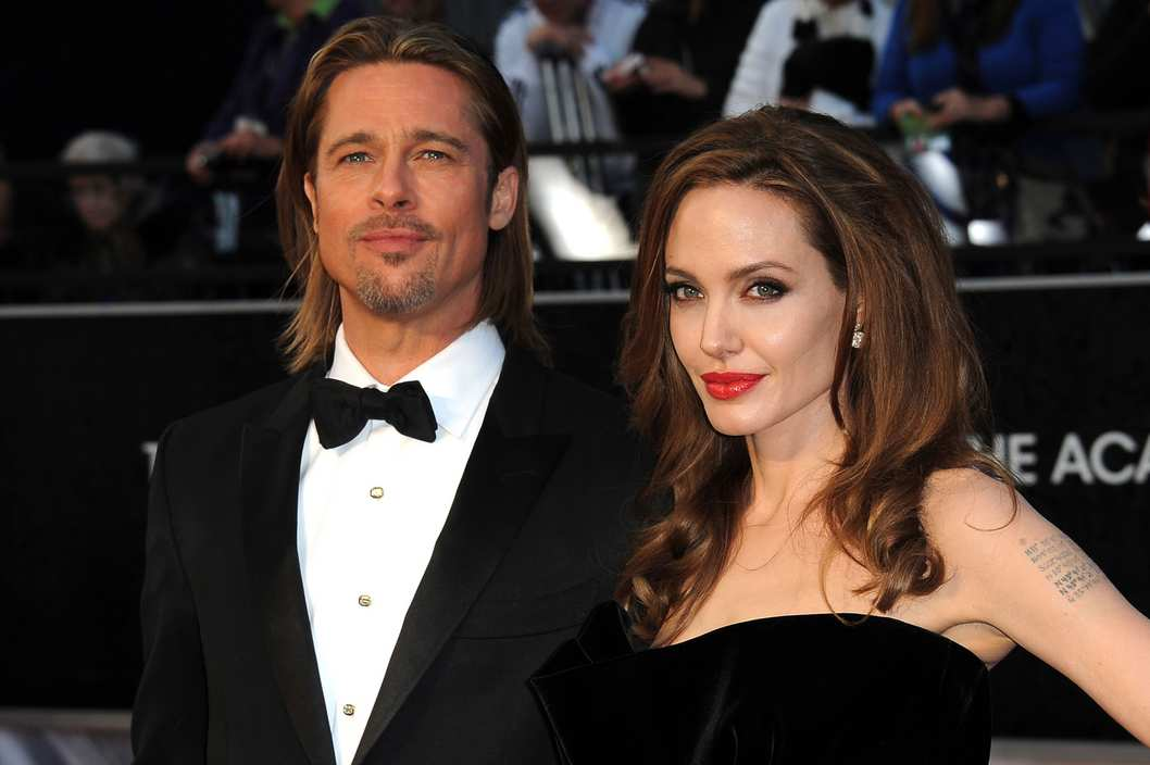 A file photo dated 26 February 2012 of US actors Brad Pitt (L) and Angelina Jolie (R) arriving for the 84th annual Academy Awards at the Hollywood and Highland Center in Hollywood, California, USA. One of the most eagerly awaited weddings in the history of Hollywood is finally about to happen. Brad Pitt and Angelina Jolie are officially engaged, a spokesman for the couple told People.com on 13 April 2012. Jolie, 36, and Pitt, 48, have been together since 2005, and have six children together: Maddox, 10, Pax, 8, Zahara, 7, Shiloh, 5 and twins Knox and Viv, 3.